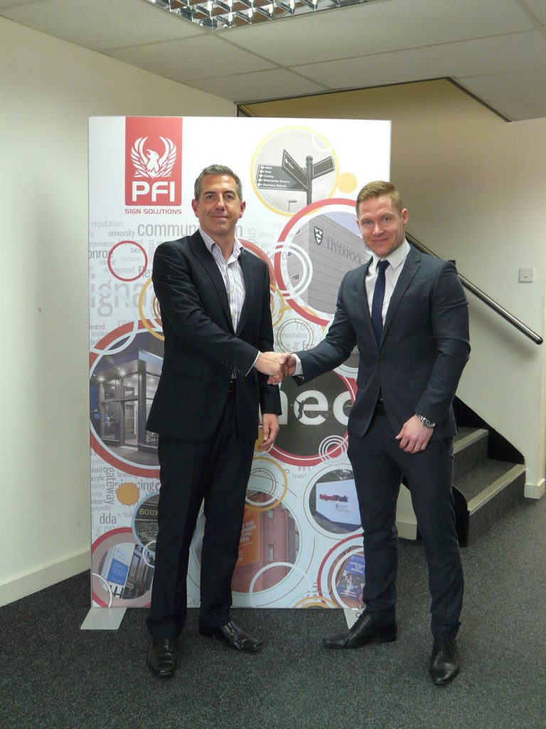 PFI Group CEO Darren McMurray (left) and Sign Plus Ltd MD James Barbour shake hands following acquisition of Sign Plus Ltd into the PFI Group
